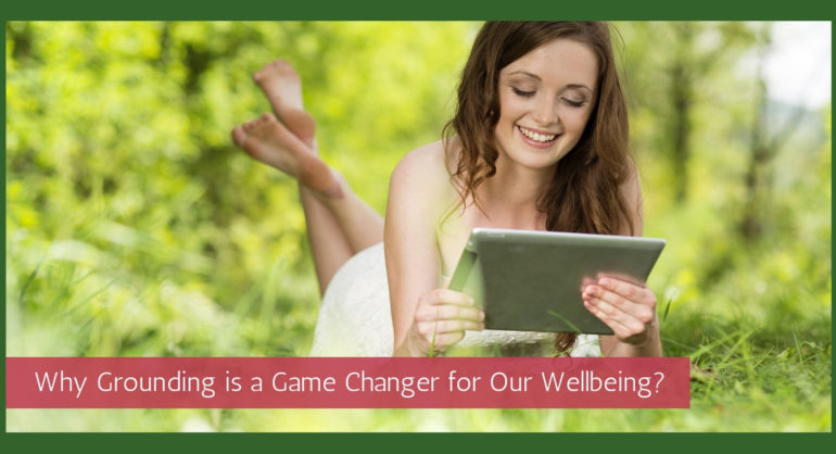 woman ipad tablet grass bare feet grounding wellbeing healthy mind feel happy business