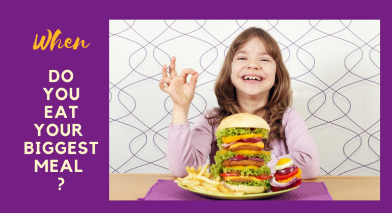 little girl eating a massive hamburger
